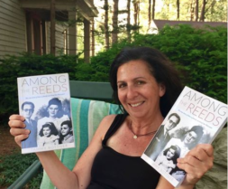 Tammy Bottner holding two books of Among the Reeds
